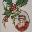 Antique Christmas Postcard Santa Claus and Holly Posted Divided