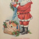 Antique Christmas postcard Santa Claus filling stockings USA unposted undivided
