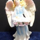 Christmas Figurine Angel carrying a Baby  made of resin