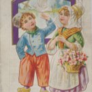 Antique Easter Postcard Little Dutch Boy and Girl White Dove Embossed