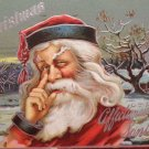 1909 Christmas postcard Santa Claus Touching His Nose embossed posted divided