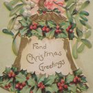 Antique Christmas postcard bell with holly 1906 posted undivided