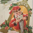 Antique Christmas postcard Santa Claus 1910 embossed posted divided