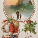 Antique Christmas postcard Santa Claus going down chimney embossed unposted