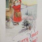 Christmas postcard Santa Claus nailing holly by window unposted divided