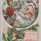 Antique Christmas postcard Santa Claus Ringing a Bell posted divided