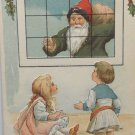 Antique Christmas Postcard Santa Claus Dressed in Gray Shirt with Red Hat