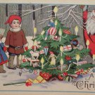 Antique Christmas postcard Santa Claus looking Around Tree Posted Divided