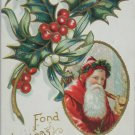 Antique Christmas postcard Santa Claus Holly Embossed Posted Divided