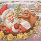 1908 Christmas postcard Santa Claus feeding candy cane to reindeer unposted