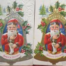 Two Antique Christmas Postcards Santa Claus on a Bell Posted Divided Embossed