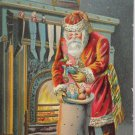Antique Christmas postcard Santa Claus filling stockings posted divided