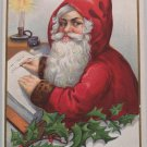 Antique Christmas Postcard Santa Claus Writing in Book Wearing Red with Hood