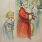 Antique Christmas postcard Santa Claus Wearing Red Coat with Blue Hat Has a Doll