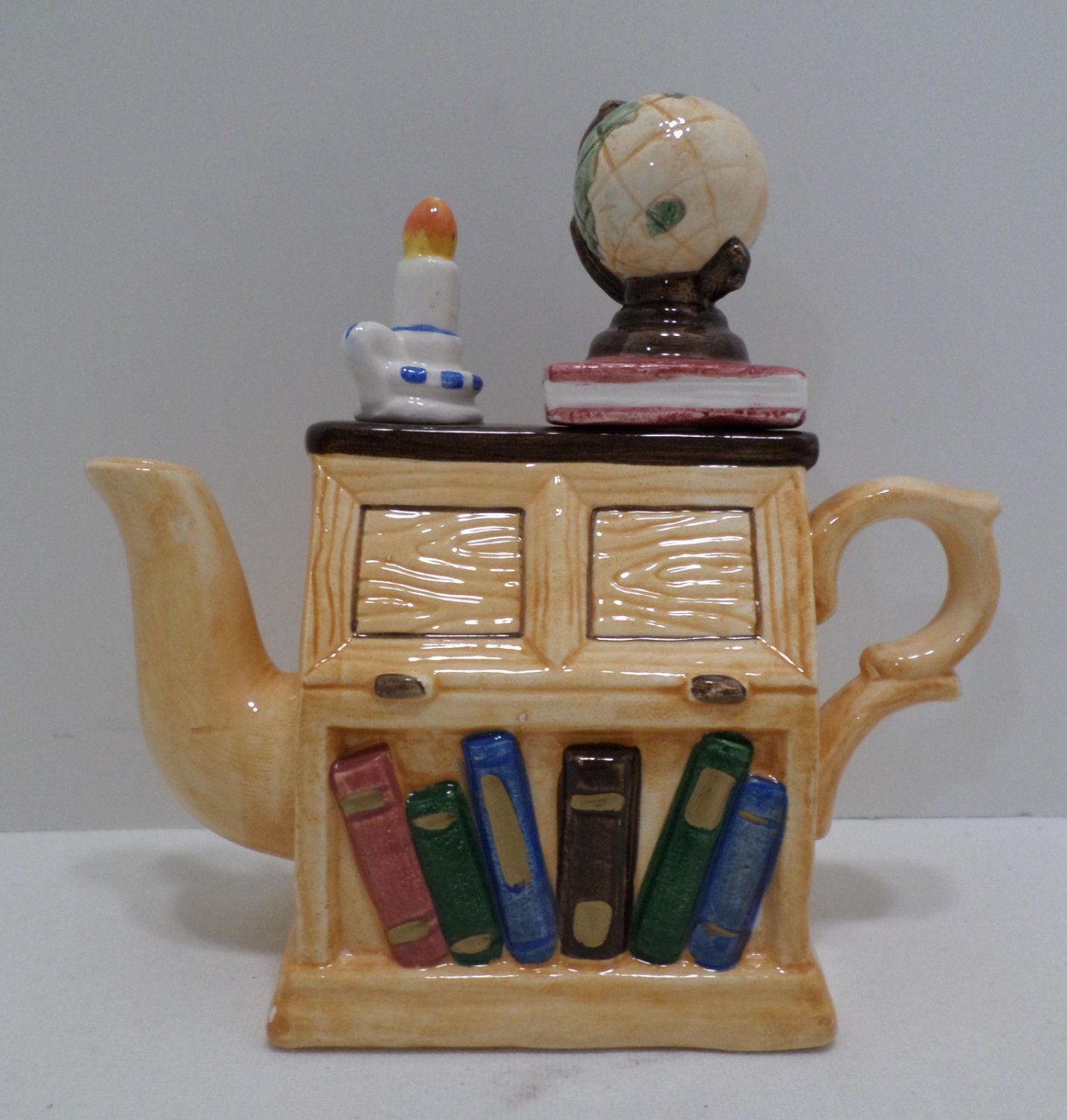 Vintage Teapot Porcelain Desk with Globe Candle and Books