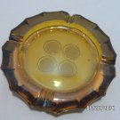 Ashtray Amber Glass with a Coin Design on the Bottom