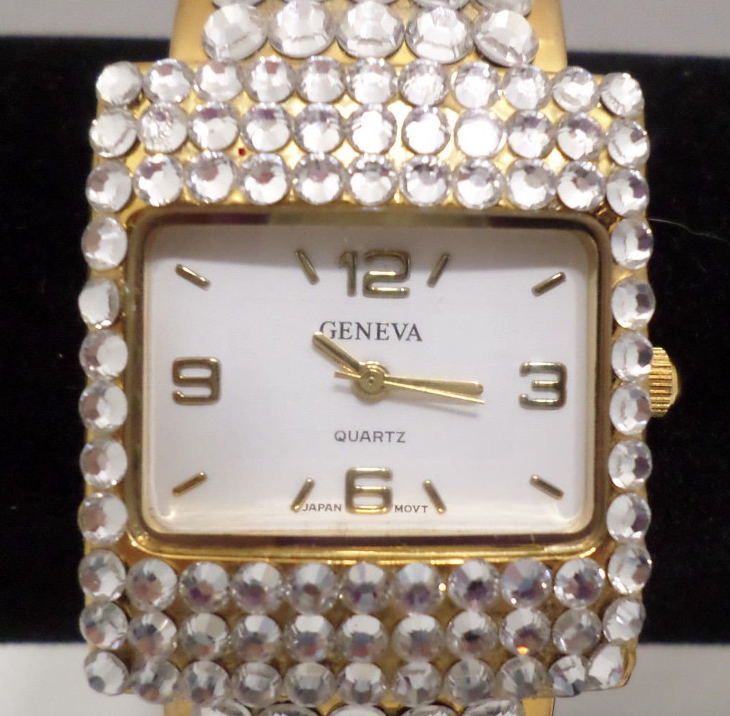 Geneva Ladies Wristwatch Gold Tone Metal with Rhinestones Cuff Band