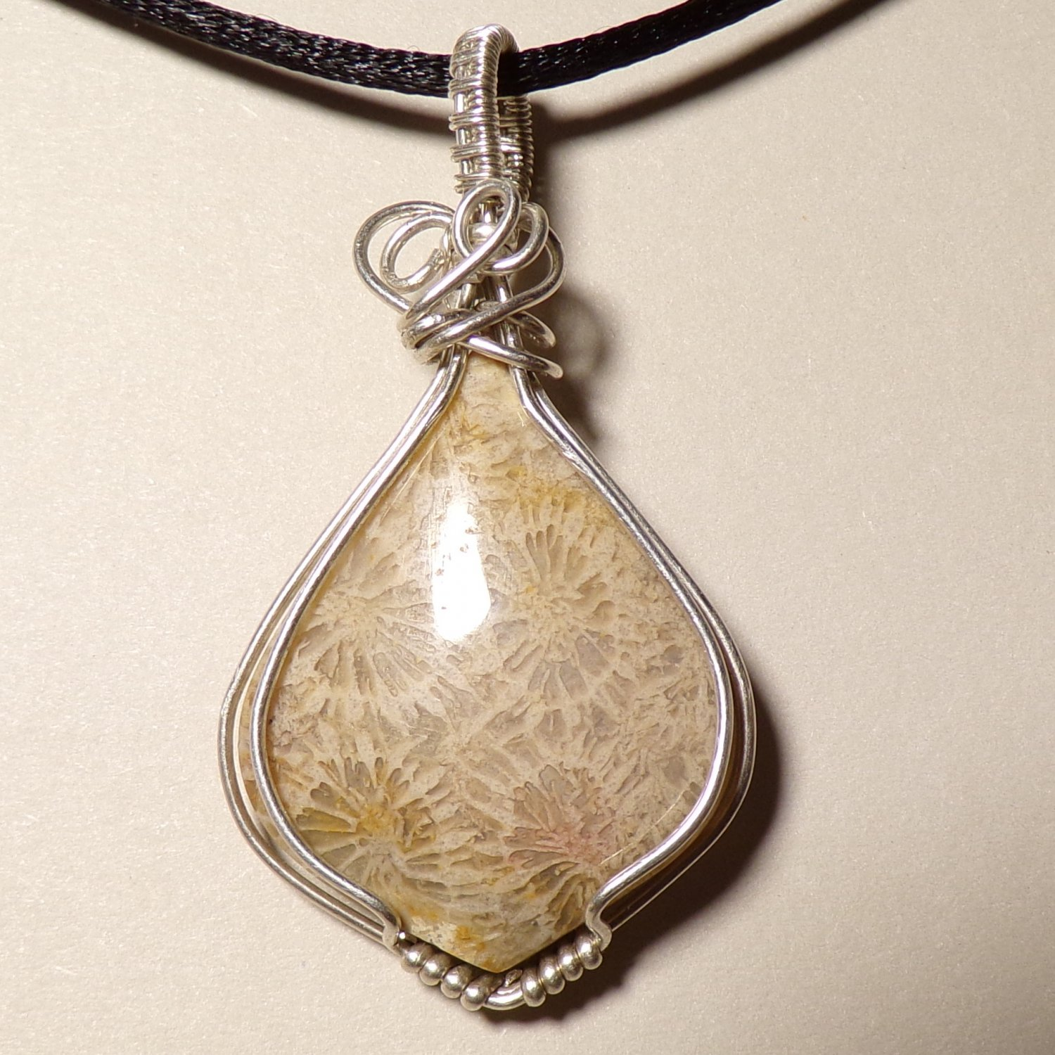 Fossil coral wrapped in Sterling silver