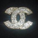 Crystal/gold fashion brooch