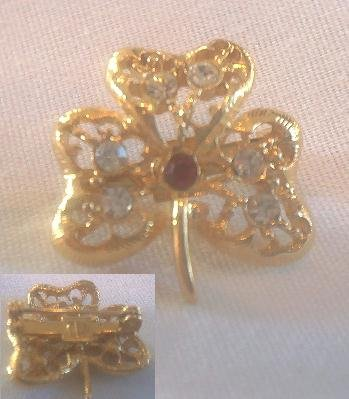GOLD SHAMROCK BROOCH WITH CRYSTAL & RED STONES