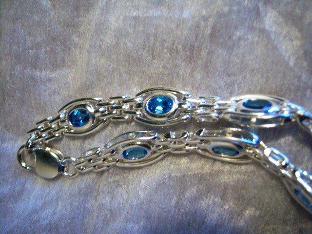 Sterling Silver handmade link bracelet with Blue Topaz gemstones.