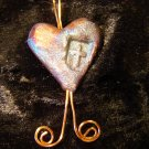 raku heart with cross pendant