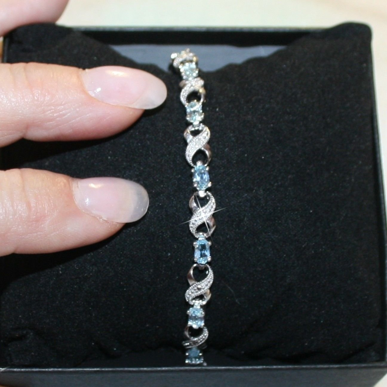 Blue Topaz Gemstone X O Tennis Bracelet 14k White Gold over 925 SS