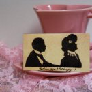"Magnet from Old Fashioned Postcard Black Silhouette of Couple ""Stingy! Stingy!"""