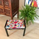 Vintage stool upholstered with exclusive Otomi fabric.