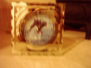 small clock with dolphins