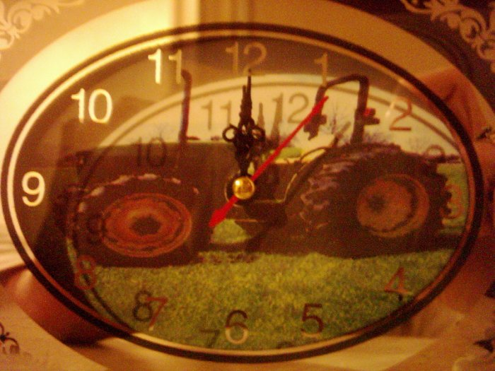 small glass clock with tractor