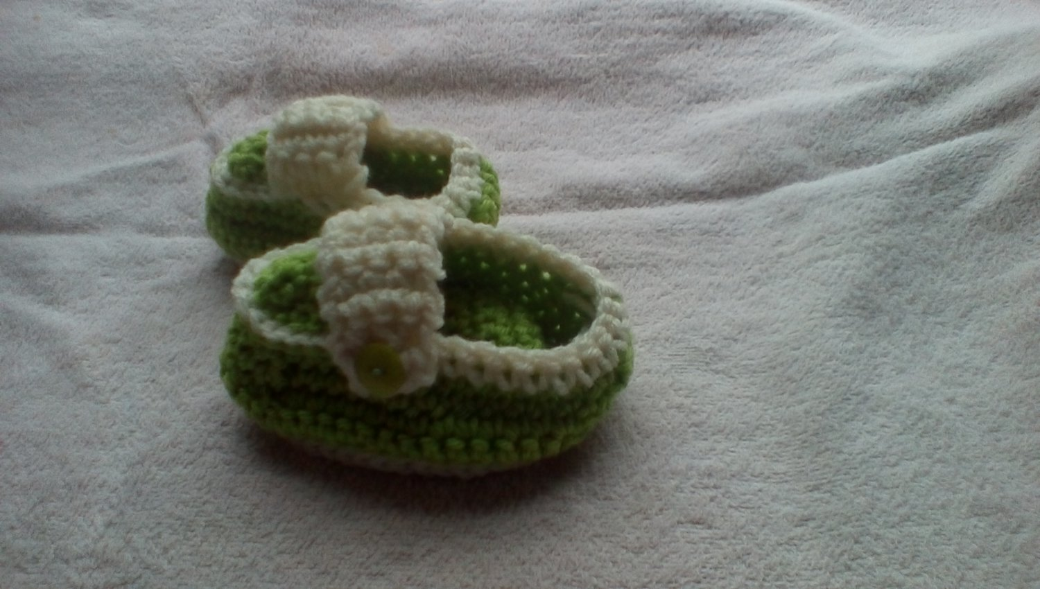 Light green newborn button sided loafers