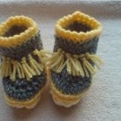 Newborn two toned yellow,and gray moccasins