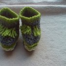 Newborn two toned  light green, and gray moccasins