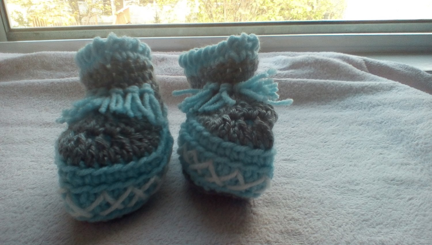 Newborn two toned  light blue, and gray moccasins