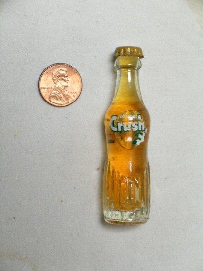 Orange Crush miniature Soda pop Bottle ACL pyroglaze 1970's Light orange color
