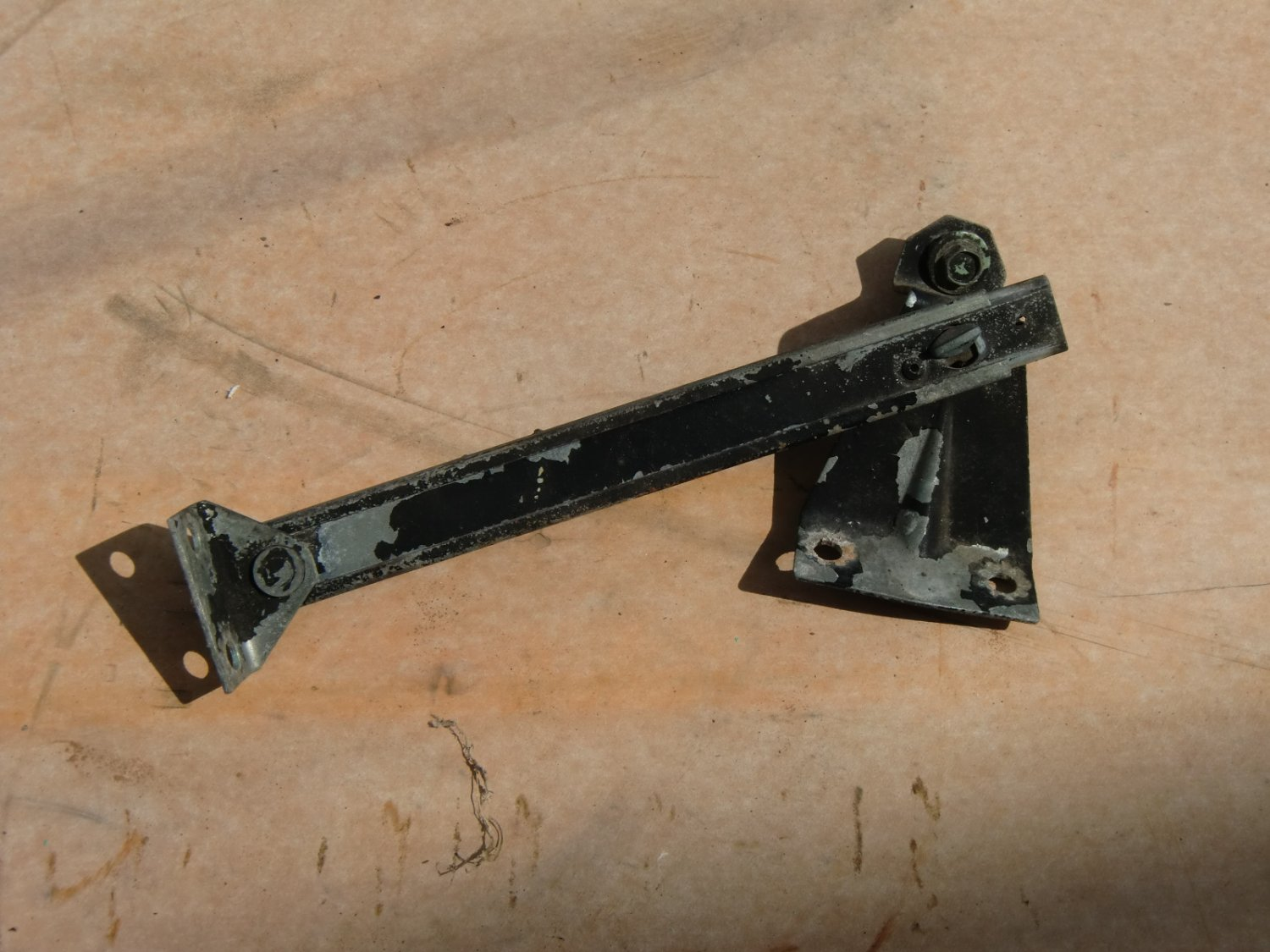 Engine hood lid lift support bracket, used 1960 Chevrolet Corvair, model 700, 6 cyl., 4 dr