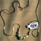 "16""  Silver Necklass w/9beads  $5.00"