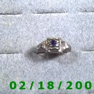 Silver Ring size 7 w/small blue stone
