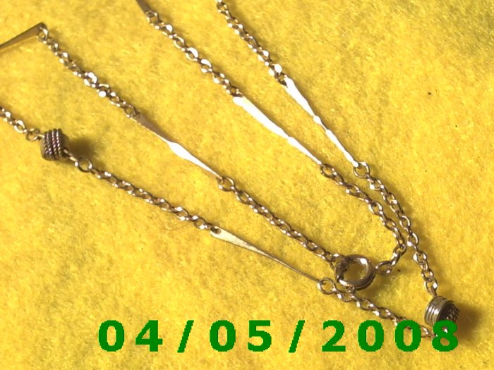 Gold Necklace w/knots and bars    E5012