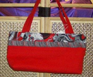 Red Handbag with Black Music Trim