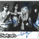 "Motley Crue (Lee, Neil, Mars & Sixx) 8 x 10"" Autographed Photo - (Ref:1154)"