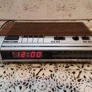 1980's General Electric Alarm Clock Radio -  Woodgrain Finish 7-4634B