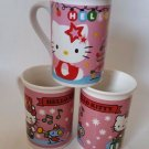 Hello Kitty Christmas themed mugs 2 patterns 14.95 Each presents mouse teddy