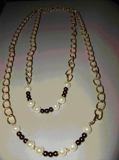 2 strand gold chain featuring cream and burgundy pearls