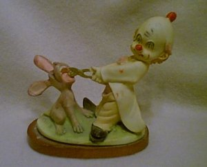 Clown Hobo Pulling Rabbits Tooth Figurine