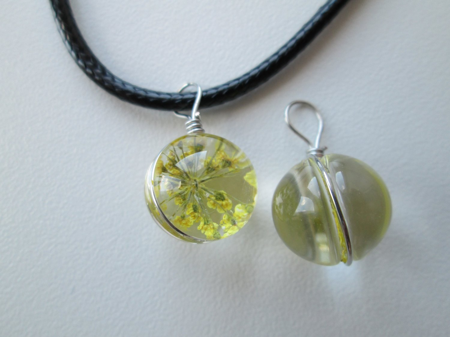 Dried pressed flower resin orb necklace.