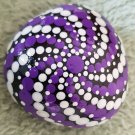 Purple and white painted rock
