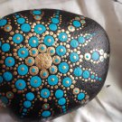 Blue and gold painted stone
