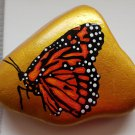Monarch butterfly on gold background